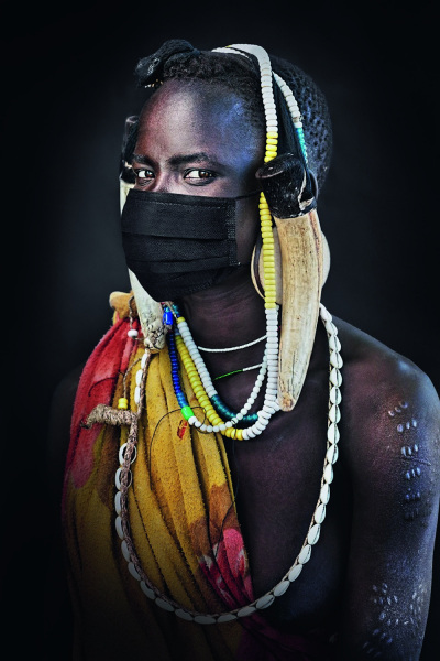 Mursi man in a mask