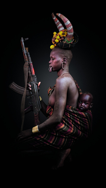 A Mursi woman and her AK-47