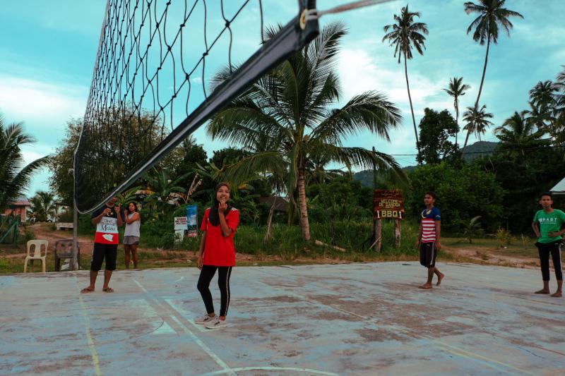 Girls playing volleyball on Tioman Island