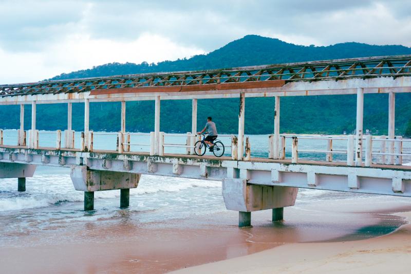 Cycling on the jetty on Tioman Island