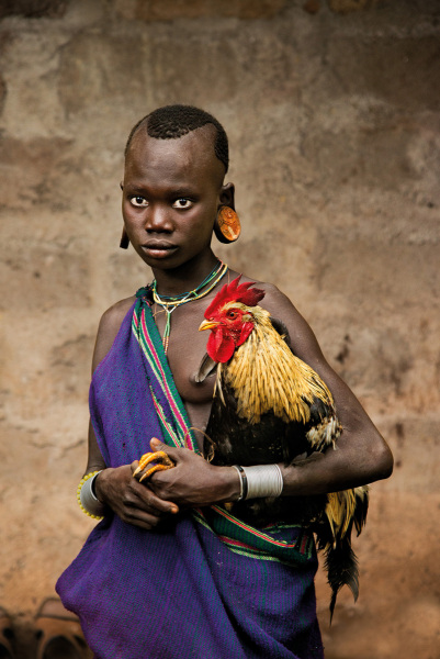 Girl and her rooster – Omo Valley, Ethiopia, 2013